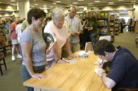 Signing for Pat, Marnie, Steve, and other folks in line